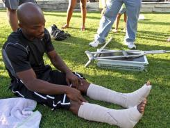 New WBO welterweight champion Timothy Bradley Jr., shows how he has both ankles wrapped to almost his knees after he returned home on Sunday. Bradley won in a split decision after a 12-round title fight against defending champion Manny Pacquiao Saturday.
