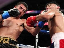 Josesito Lopez lands a ninth-round left hook Saturday to the jaw of Victor Ortiz that led the way to victory.