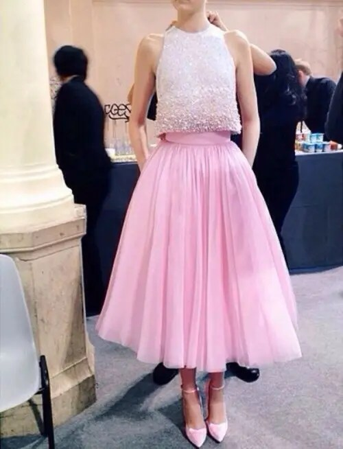 a bright and glam look with an embellished sleeveless crop top, a pink tutu skirt and pink shoes for a glam wedding