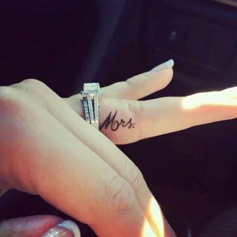 A small and elegant wedding tattoo of Mrs. done in cursive on the side of your finger is a chic girlish idea
