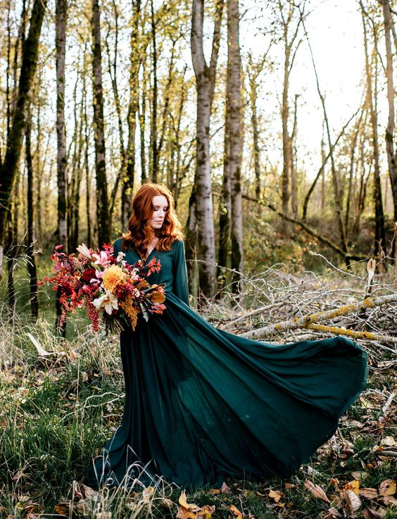 an emerald green maxi wedding dress with long sleeves and a pleated skirt plus long sleeves for a fall bride