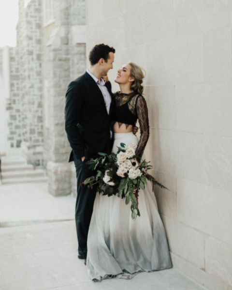a black top plus a lace coverup with long sleeves, an ombre maxi skirt from white to grey
