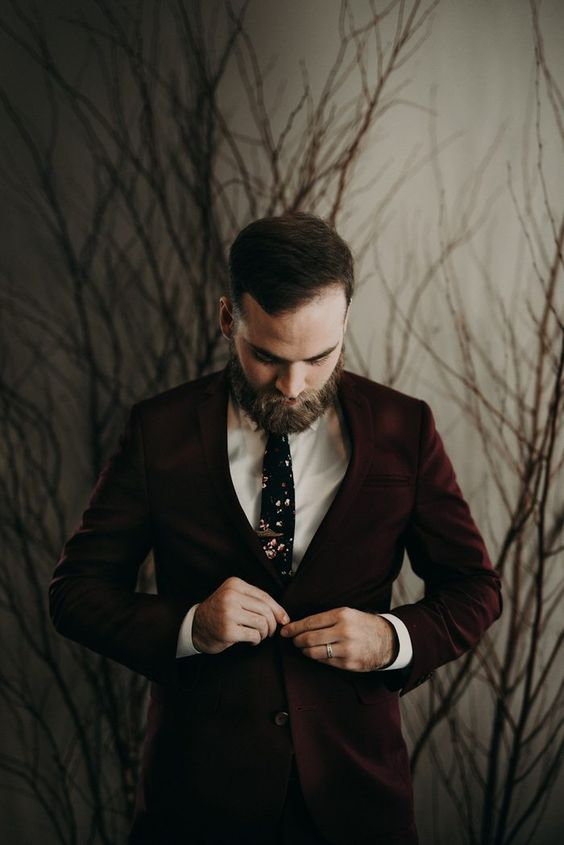 a burgundy suit, a white shirt and a dark floral tie for a moody Halloween look