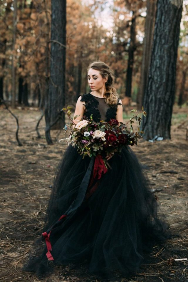 a gorgeous black sleeveless wedding ballgown with lace appliques is a stylish idea for an offbeat bride