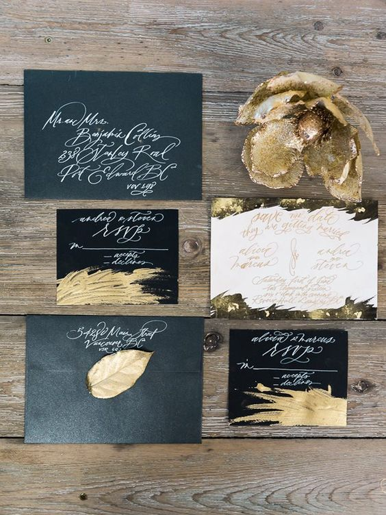 black and white wedding stationery with touches of gold is very chic