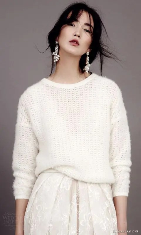 a white slouchy sweater over a romantic wedding dress will keep you warm and show off the skirt anyway