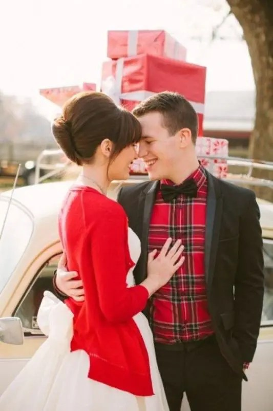 a red cardigan over a wedding dress will give your look a Christmassy feel