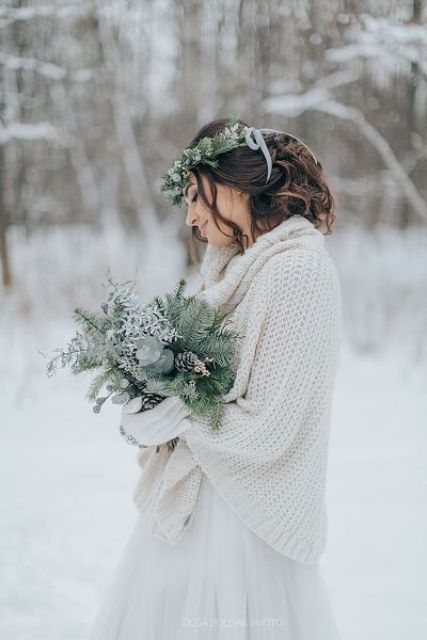 a creamy slouchy chunky knit sweater over your neutral wedding gown to feel warm