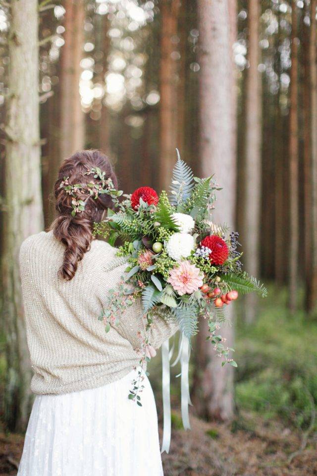 a neutral slouchy sweater with a touch of sparkle over the wedding dress for a woodland bridal look