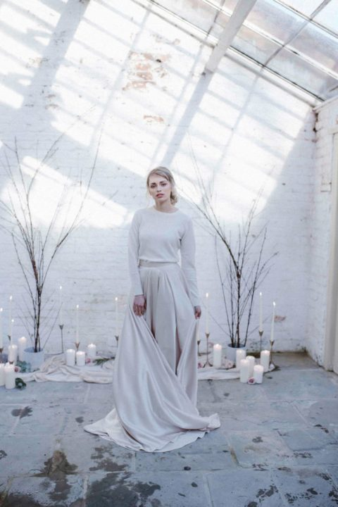 a white cashmere jumper plus an off-white A-line skirt with a train for a minimalist bride
