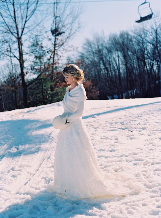 a white wrap sweater over the wedding dress looks very elegant and refined