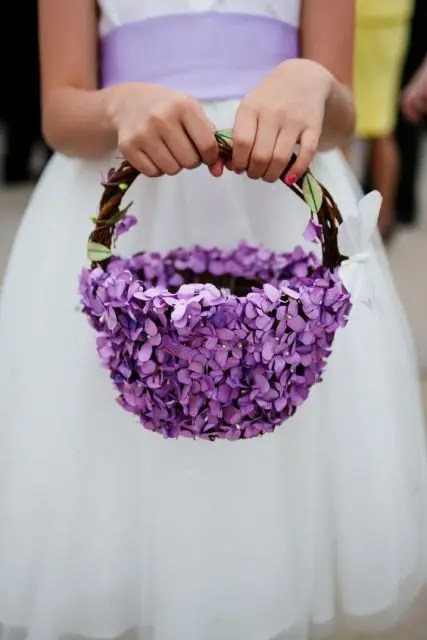 a vine basket with purple blooms all over is a gorgeous idea for a girlish look