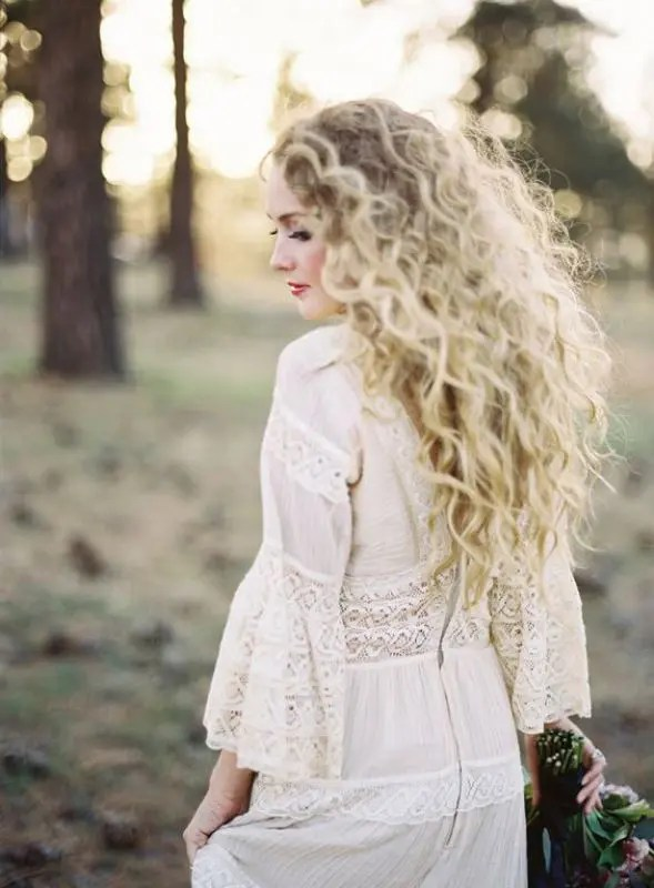 a bush or natural blonde curls is a very romantic hairstyle for every bride, be sure to rock your curls