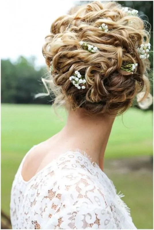 raise your curly hair into a comfy and chic updo and add some fresh blooms