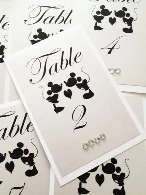 black and white Mickey and Minne table numbers with rhinestones are a cute and simple stationery idea