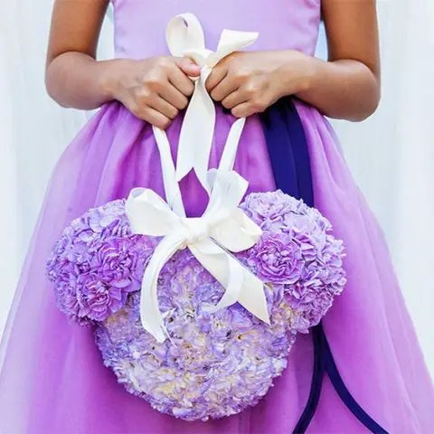 a purple flower Mickey Mouse head with a ribbon bow is a fun subsitute of a usual basket ith petals