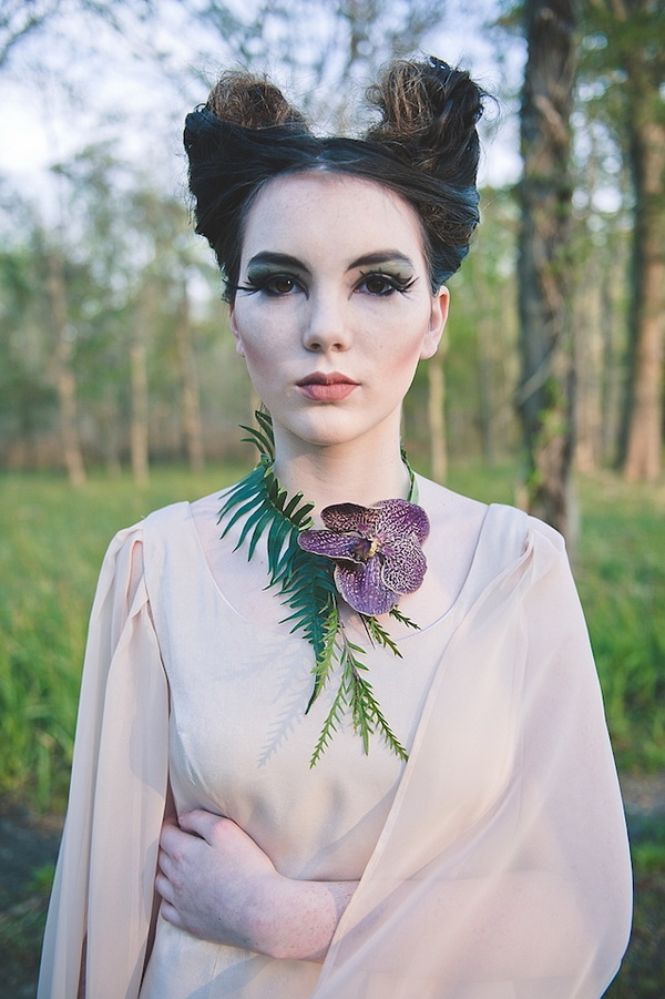 a Maleficent bride rocking her unique hairstyle, a bold makeup, a fresh orchid necklace and a neutral wedding dress
