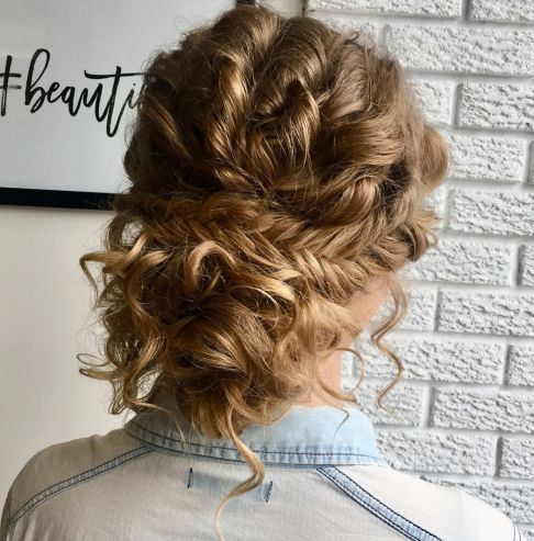 a loose curly updo with fishtail braid is neat and tame, it's trendy and very boho-like