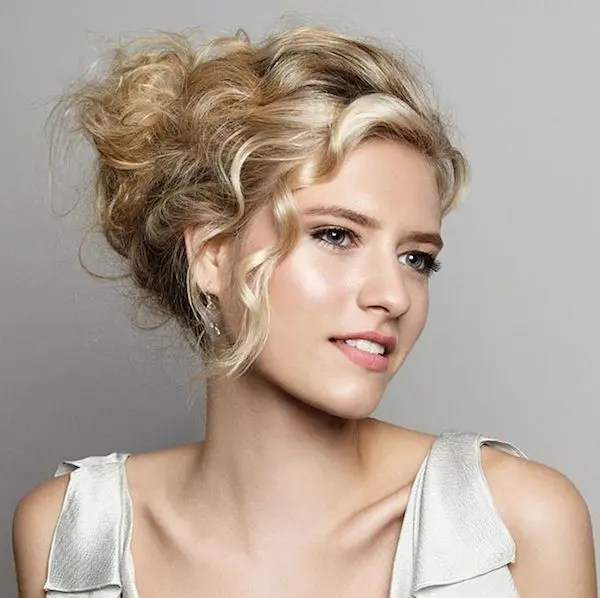 a messy updo with a chignon, a messy bump and soem bangs is a refined and elegant option