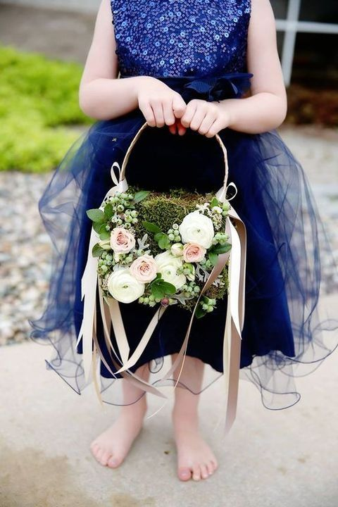 a moss basket decorated with lush florals and berries plus blush ribbon accents is a very chic idea