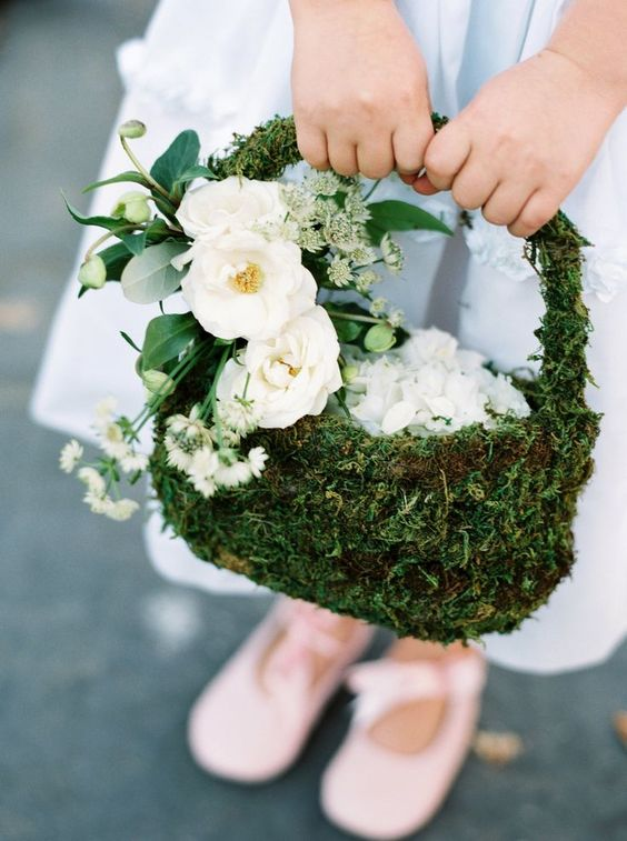 a moss flower girl basket decorated with white blooms and seeded eucalyptus is a stylish idea foa woodland wedding