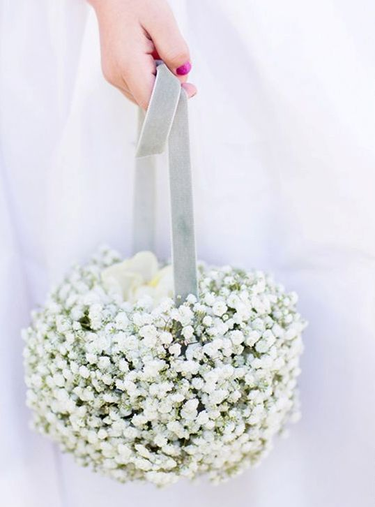 a pomander ball basket of baby's breath and blue velvet ribbon is a chic and refined idea