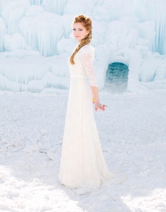 an Elsa-inspired bridal look with a white lace fitting dress and an Elsa's braid