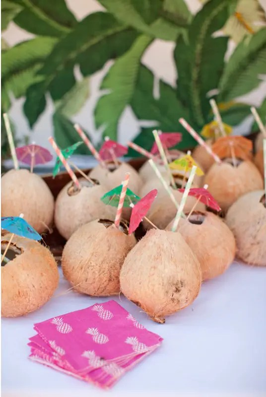 coconuts as cocktail glasses and colorful umbrellas will make your gals feel in tropics