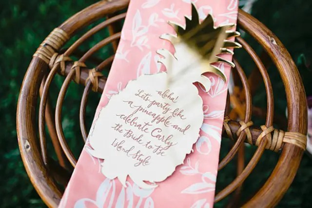 a tropical bridal shower invitation styled as a half pineapple with calligraphy
