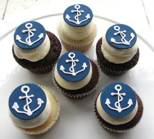 vanilla and chocolate cupcakes with anchor toppers are a great themed treat for a nautical bridal shower