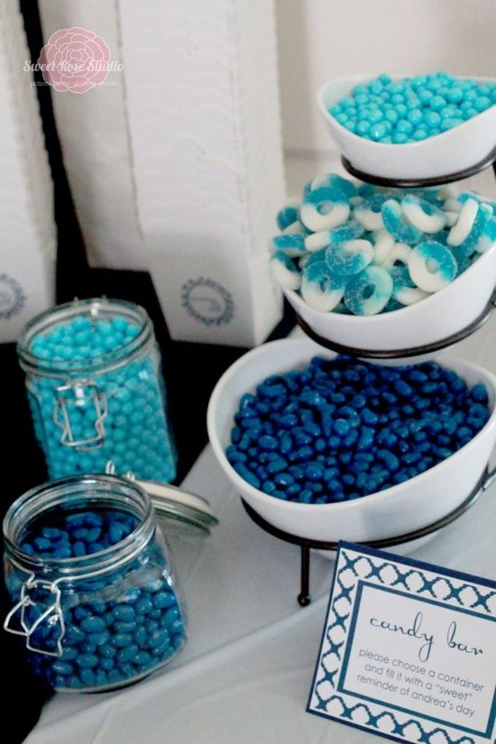 a candy bar with turquoise, navy candies and blue and white jelly candies is a cool and simple idea for a nautical bridal shower
