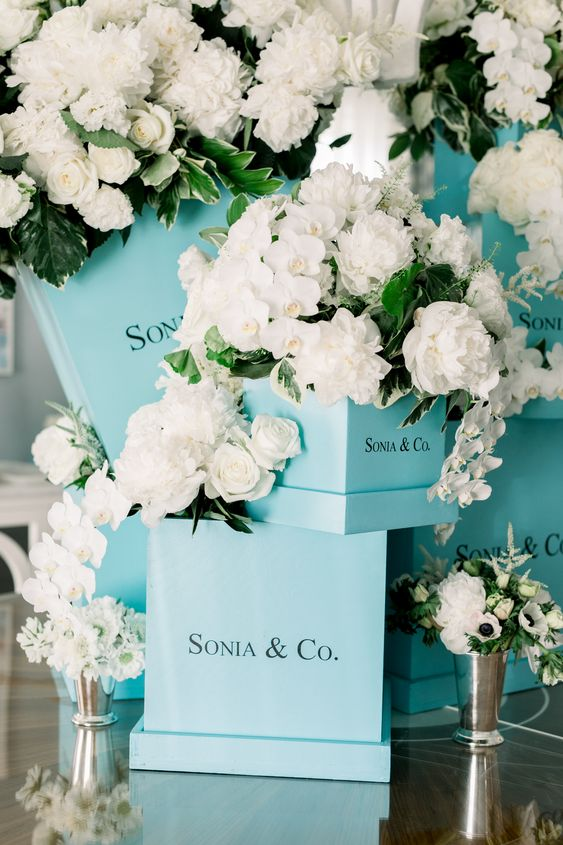98bc80993c a fun bridal shower decor idea with tiffany blue boxes, white roses,  greenery and