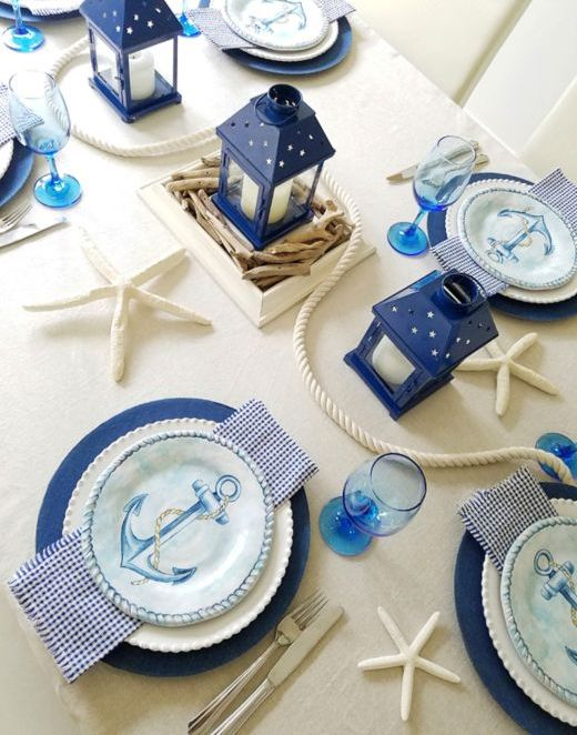 a simple nautical bridal shower setting in cream and navy plus bright blue touches, rope, starfish, anchor plates and candle lanterns