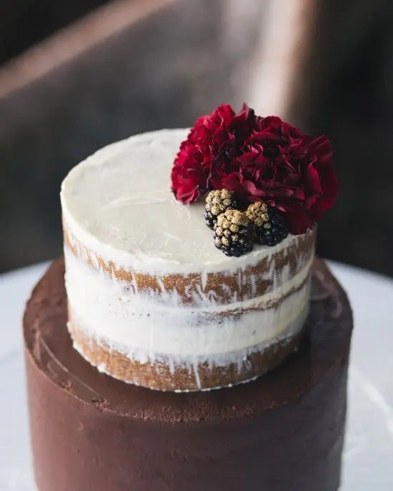 naked blackberry cake with a dark rose