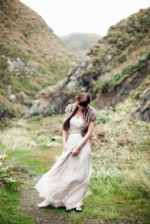 brown faux fur vest and a nude wedding dress