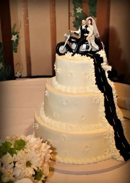 20 Cool Motorcycle Themed Wedding Ideas   Weddingomania Three tiered cake with original cake topper