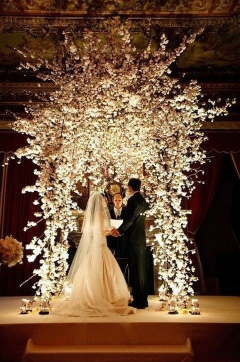 lush white floral wedding arch is perfect for winter wonderland weddings