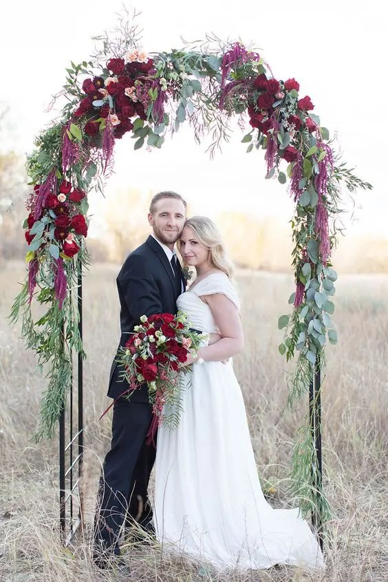 eucalyptus leaves and bold red flowers are ideal for a Christmas wedding