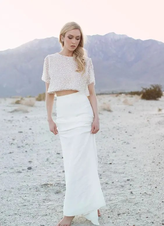 unique bridal separate with a beaded sleeve top and a slim skirt