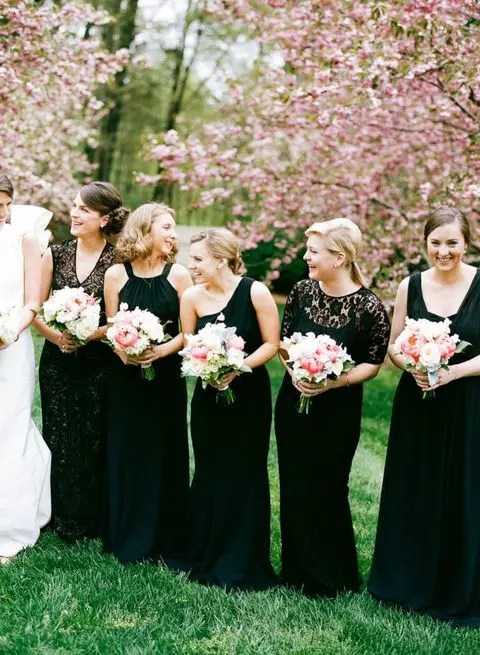 bridesmaids in black with blush bouquets