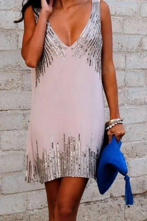 blush embellished dress with a plunging neckline