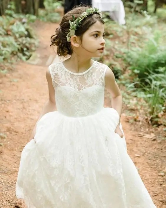 illusion sweetheart neckline ivory dress with a layered skirt (a cute hairstyle is a nice bonus)