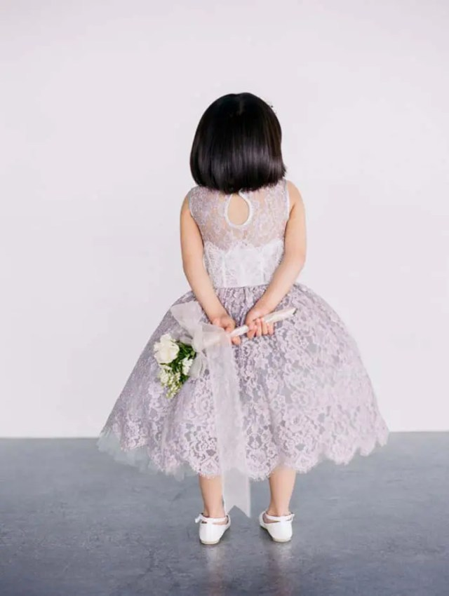 lilac-colored lace dress with a keyhole back and a midi skirt