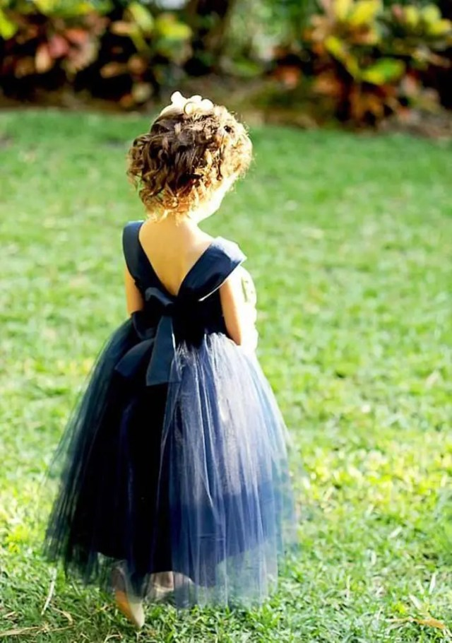 navy dress with a V back and a layered tulle skirt
