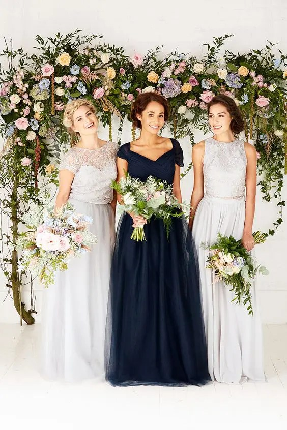 different lace tops and maxi skirts of the same shade for bridesmaids