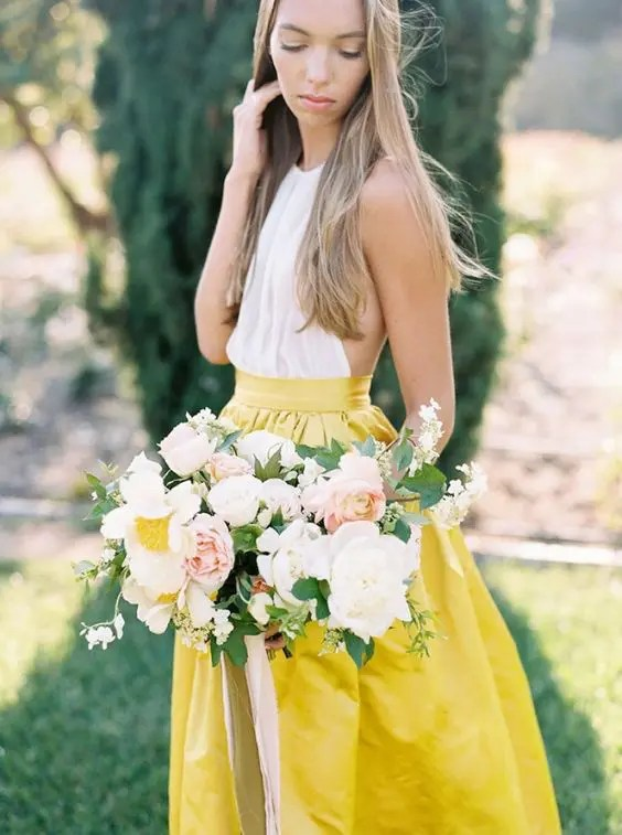 sunny yellow midi skirt and a white top