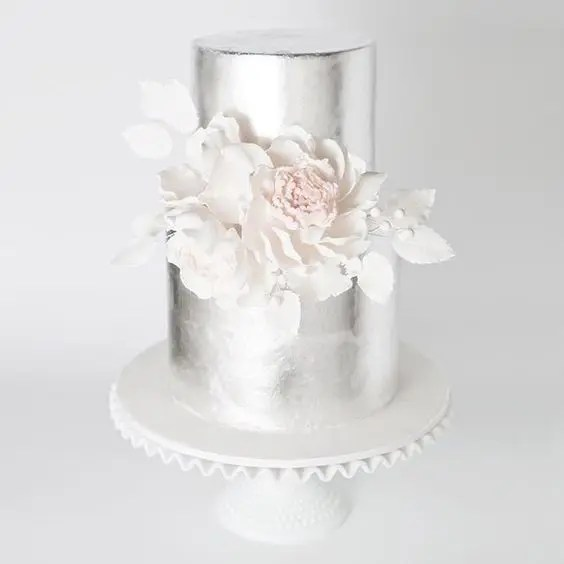 Picture Of silver wedding cake with edible white cream flowers