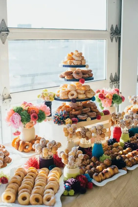 colorful donut bar with bold pompom decor