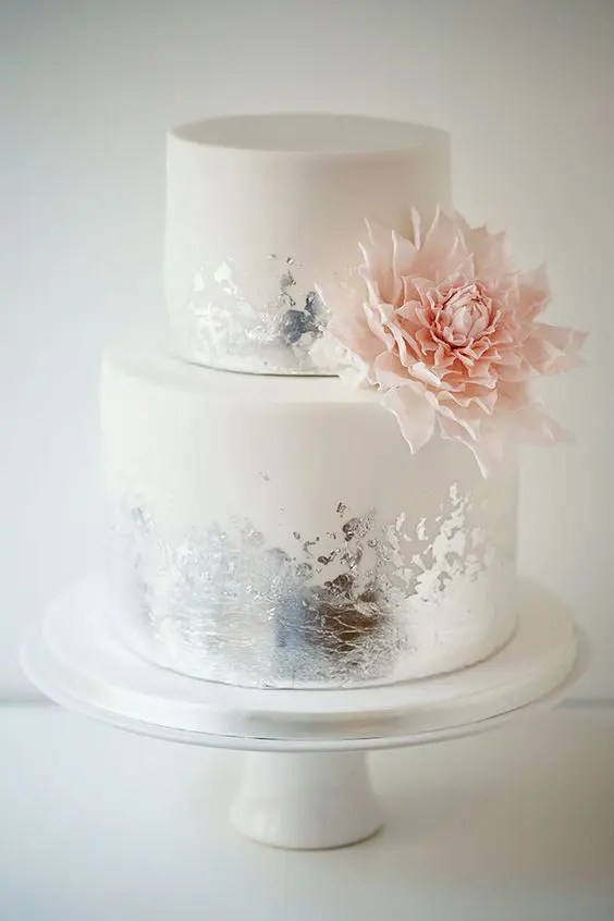 Picture Of white wedding cake with distressed silver leaf ans sugar     Picture Of white wedding cake with distressed silver leaf ans sugar pink  dahlia