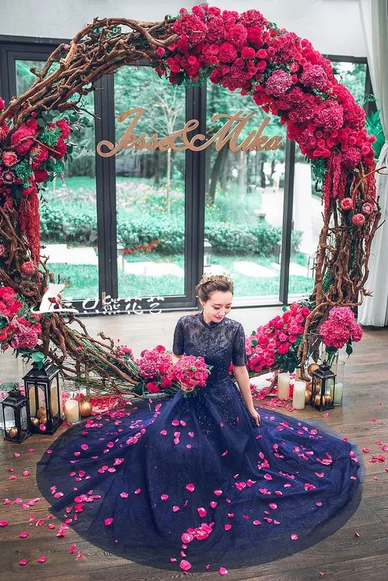 11 more giant wedding wreaths the hottest wedding trend crazyforus gorgeous bold red and fuchsia wreath as a wedding backdrop lanterns and candles all around junglespirit Choice Image